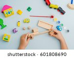 child collects and paints a... | Shutterstock . vector #601808690