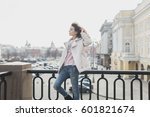 young girl walking in the city... | Shutterstock . vector #601821674