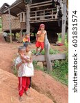 Small photo of Luang Namtha prov., Laos-October 6, 2015: The Akha hill tribe are an ethnic minority living in the mountains between E.Myanmar-N.Thailand-W.Laos-S.China. Kids greet the tourists visiting their village