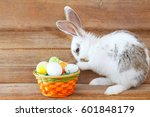 Stock photo easter rabbit and a basket with easter eggs 601848179
