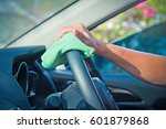 hand cleaning the car interior... | Shutterstock . vector #601879868