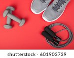 sport shoes  dumbbells and... | Shutterstock . vector #601903739