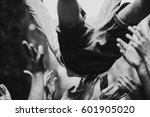 people throw up man in shorts | Shutterstock . vector #601905020