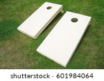 wooden cornhole boards on grass | Shutterstock . vector #601984064