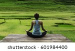 young woman practicing yoga... | Shutterstock . vector #601984400