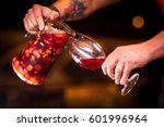 Man Serving A Glass Of Sangria