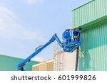 worker man on a scissor... | Shutterstock . vector #601999826