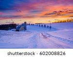 Sunset Over A Snow Covered Road ...
