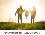 happy parents playing with... | Shutterstock . vector #602041913