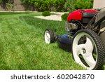lawn mower on green grass  | Shutterstock . vector #602042870