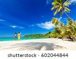 a loving couple enjoying the... | Shutterstock . vector #602044844