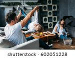cute parents play with their... | Shutterstock . vector #602051228