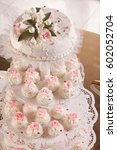 wedding cupcakes and cake on... | Shutterstock . vector #602052704
