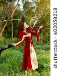 Small photo of Asia Woman perform music on violin in park outdoor. Girl performing jazz in forest