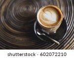 cup of hot latte art coffee on... | Shutterstock . vector #602072210