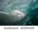 beautiful girl surfing in... | Shutterstock . vector #602096450