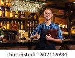 portrait of cheerful barman... | Shutterstock . vector #602116934