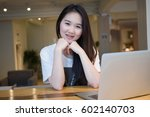 asian woman in coffee shop with ... | Shutterstock . vector #602140703