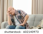 senior man suffering from... | Shutterstock . vector #602140973