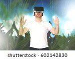 young man using a vr   virtual... | Shutterstock . vector #602142830