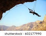 Rock Climber Pulling Himself U...