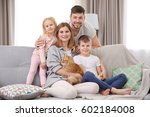 parents with children and cat... | Shutterstock . vector #602184008