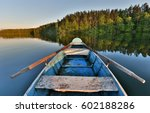 Fishing Boat In A Calm Lake...