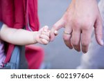 close up of father holding his... | Shutterstock . vector #602197604