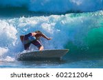 riding the waves. costa rica ... | Shutterstock . vector #602212064