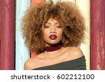 portrait of attractive black... | Shutterstock . vector #602212100