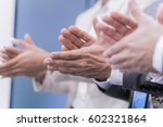 Small photo of Close-up of business people clapping hands. Business seminar concept