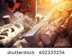 chainsaw in action cutting wood....   Shutterstock . vector #602335256
