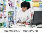 female chemist writing on... | Shutterstock . vector #602339270