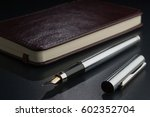fountain pen with a diary on... | Shutterstock . vector #602352704