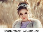 outdoor portrait of a pretty... | Shutterstock . vector #602386220