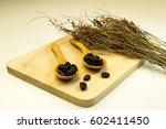 coffee beans in wooden spoon... | Shutterstock . vector #602411450
