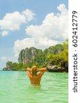 woman on the thai beach of... | Shutterstock . vector #602412779