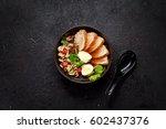 Ramen Soup On A Black Bowl Ove...