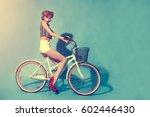 girl on bike in retro style | Shutterstock . vector #602446430