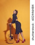 the girl leans on the guitar | Shutterstock . vector #602446484