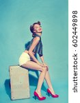 girl with suitcase in retro... | Shutterstock . vector #602449898