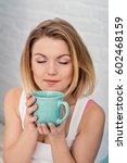 morning with a cup in woman... | Shutterstock . vector #602468159