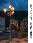 Small photo of Saint-Gervais-Les-Bains, France - June 24, 2016. Night view of city hall and street with lamp in Saint-Gervais-Les-Bains, a famous ski resort in Haute-Savoie, near the Mont Blanc in the French Alps