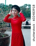 Small photo of Hanoi, Vietnam - October 16, 2016: Undefined Vietnamese girl shooting for wedding photo album in Garden park in Hanoi ,It'is a very important job for the customary marriage, image wedding background