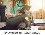 young caucasian woman using... | Shutterstock . vector #602488628
