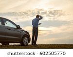 men near the car at sunset | Shutterstock . vector #602505770