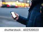 man holds in hands smartphone... | Shutterstock . vector #602520023
