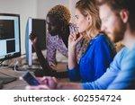 programmer working in a... | Shutterstock . vector #602554724