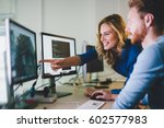 programmers cooperating at  it... | Shutterstock . vector #602577983