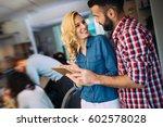 happy business colleagues in... | Shutterstock . vector #602578028